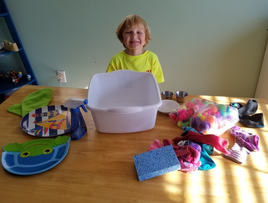 He loved helping me get is stuff ready for school next week. It all fits nicely into his tub.