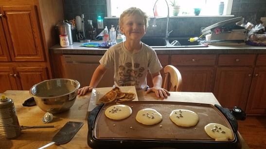 Helping make the pancakes!